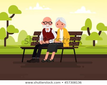 Szczęśliwy dziadkowie posiedzenia ławce parku wektora Zdjęcia stock © robuart