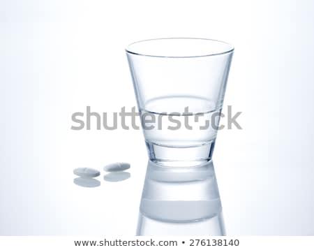Twee pillen glas water Rood Blauw Stockfoto © make