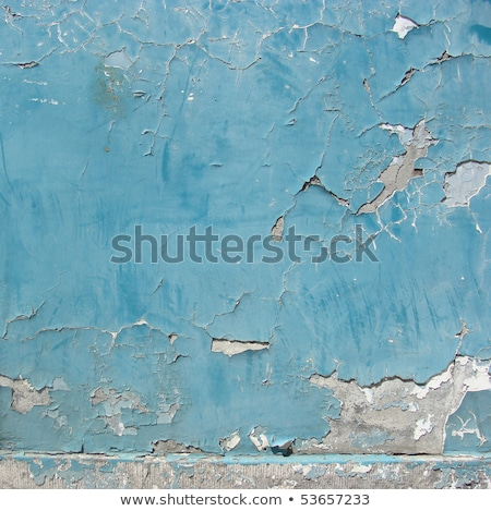 worn blue painted wall with paint chip crack and blathering stock photo © melvin07