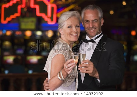 Mature man in tuxedo drinking champagne. Stock photo © RTimages