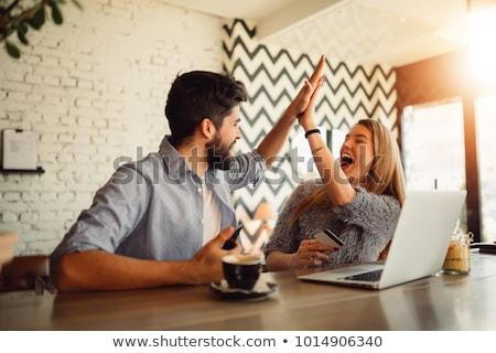 femme · regarder · utilisant · un · ordinateur · portable · ordinateur · vidéo · vie - photo stock © photography33