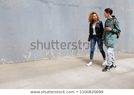 Portrait of a woman pasting wall Stock photo © photography33