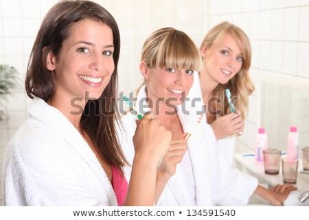 Nők szobatársak fogmosás nő mosoly szépség Stock fotó © photography33