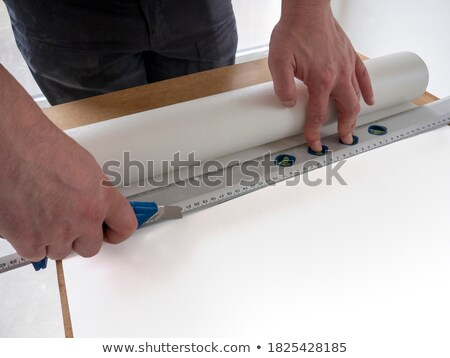 Decorator using a wallpaper table Stock photo © photography33