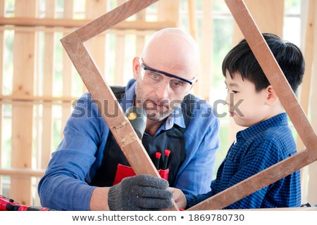 Joiner inspecting wooden frame Stock photo © photography33