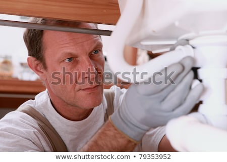Plumber hard at work Stock photo © photography33