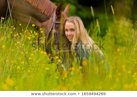 Stock photo: Blond woman with her horse