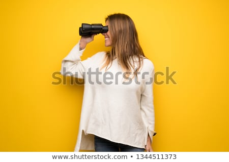 pretty woman holding binoculars stock photo © nobilior