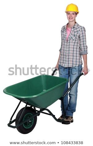 Empurrando carrinho de mão mulher madeira construção natureza Foto stock © photography33