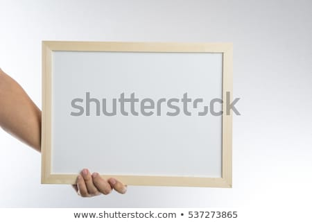 Wooden frame in hand stock photo © Taigi