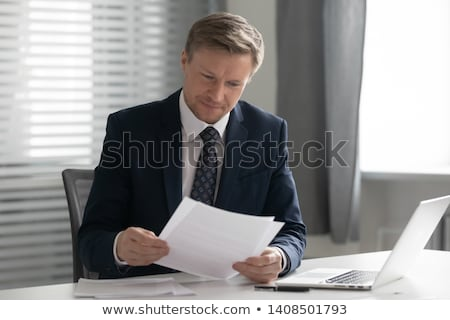 Businessman reading a letter stock photo © photography33
