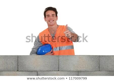 Positive mason stood by wall Stock photo © photography33