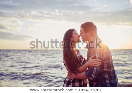 Couple sitting on a pontoon Stock photo © photography33