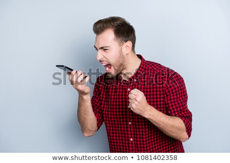 Stock photo: angry businessman shouting on his cell