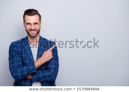 businessman pointing his finger Stock photo © dolgachov
