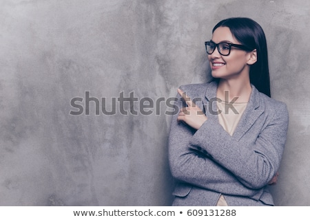 business woman standing and pointing at copy space stock photo © dash