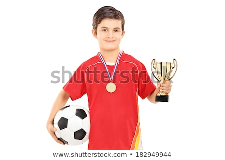 boy with gold medal and soccer ball stock photo © goce