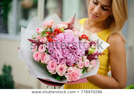 beautiful blonde portrait holding rose petals Stock photo © chesterf
