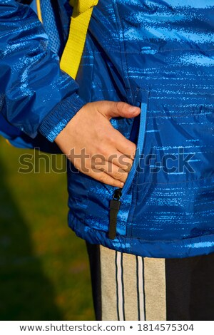 casual man with hand in pocket at sunset stock photo © feedough