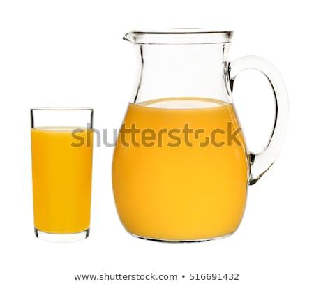 şeftali meyve suyu cam sürahi yalıtılmış beyaz Stok fotoğraf © natika