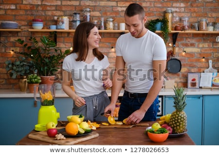 young couple preparing breakfast in modern kitchen stock photo © monkey_business