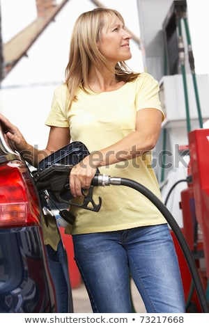 Female Motorist Filling Car With Diesel At Petrol Station Stock photo © monkey_business