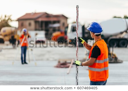 two young land surveyors at work stock photo © lightpoet