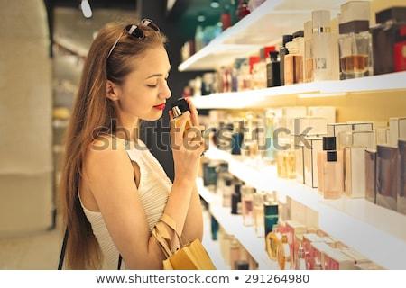 woman buying perfume in shop or store Stock photo © Kzenon