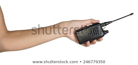 Female hand holding portable radio transmitter Stock photo © cherezoff