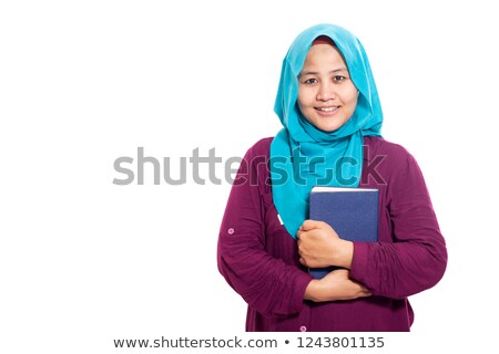 Young muslim woman with book on white Stock photo © Elnur
