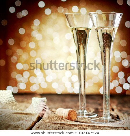 Stock photo: two glasses of champagne against festive gold background