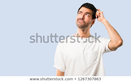 Portrait of doubtful man in shirt Stock photo © wavebreak_media