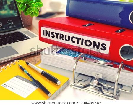 Instructions on Red Office Folder. Toned Image. Stock photo © tashatuvango