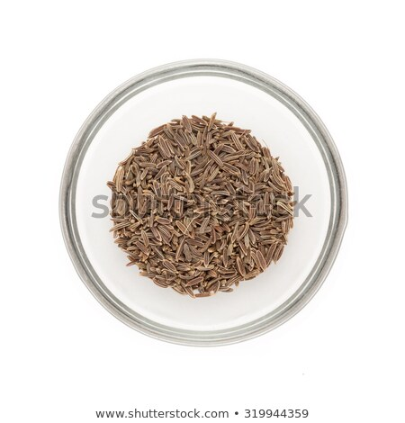 Stock photo: Top view of half filled bowl of Organic Caraway.