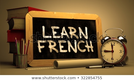 learn french   motivational quote on chalkboard stock photo © tashatuvango