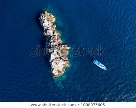 Kust afstandsbediening eiland landschap oceaan klif Stockfoto © wildnerdpix