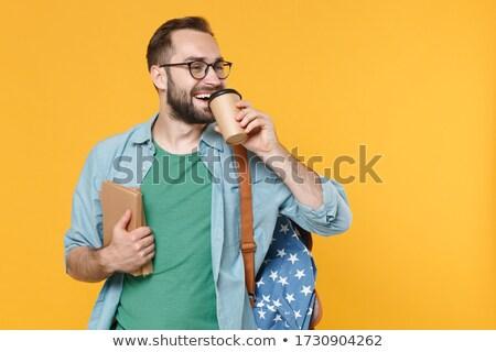 若い男 カップ ホットドリンク 読む あごひげ ストックフォト © deandrobot
