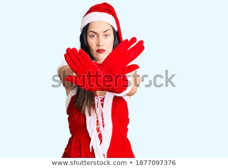stop the celebration beautiful woman in santa claus costume stock photo © stevanovicigor