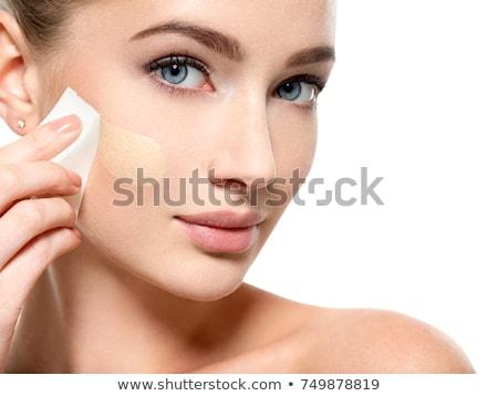 Gyönyörű lány jelentkezik alap szivacs gyönyörű fiatal nő Stock fotó © svetography