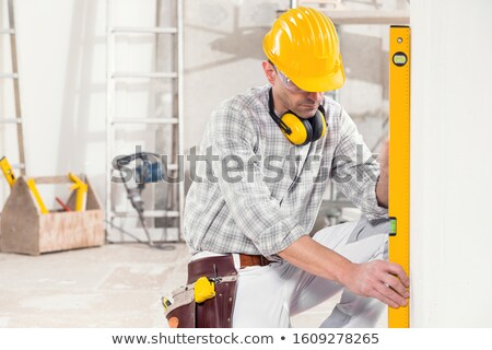 Construction worker using level tool Stock photo © zurijeta