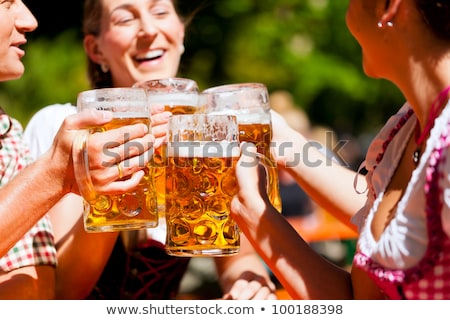 People drinking beer in a traditional Bavarian beer garden Stock photo © kb-photodesign