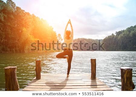 Woman in bridge yoga pose meditating at sunset. Zen Stock photo © photocreo