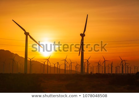 Silhouetted Wind Turbines Over Dramatic Sky Stock photo © feverpitch