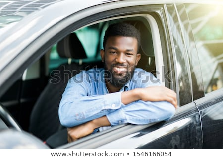 Stock photo: Happy smiling male customer testing his new car