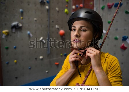Confident athlete wearing sports helmet in health club Stock photo © wavebreak_media