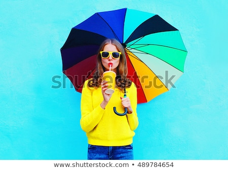 young girl with colourful umbrella stock photo © elnur
