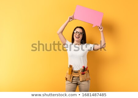 young caucasian builder with speech bubble stock photo © rastudio