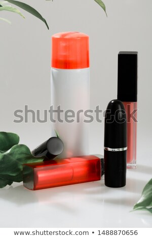 glamor red shiny lipstick and green leaf Stock photo © caimacanul