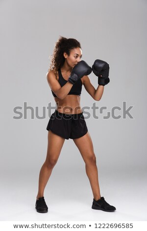Full length portrait of a muscular adult sportswoman Stock photo © deandrobot