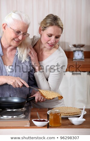 girl eating crepe with jam stock photo © is2